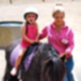 horseback riding in branson mo, shepherd of the hills, child in shock, trainer giving a ride
