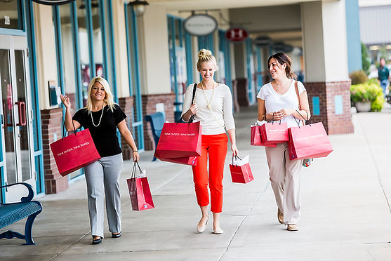 the branson landing, carrying store bags, three girls walking