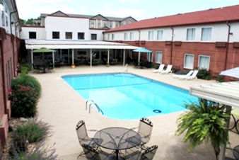 hotel with outdoor pool, patio pool, family pool, covered patios