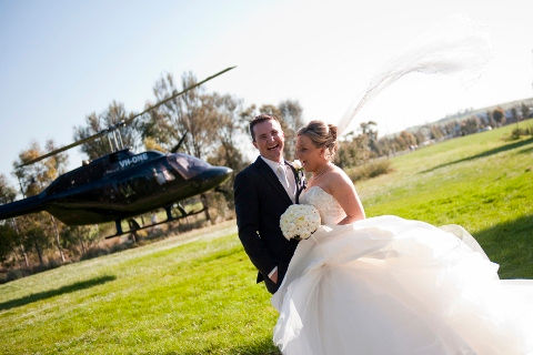 wedding couple laughing, chopper taking off, extreme vacation ideas