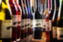 alcohol bottles, colored bright wine bottles
