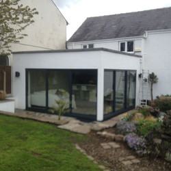 Before and after shots of a summer room we constructed incorporating aluminium sliding doors and eng