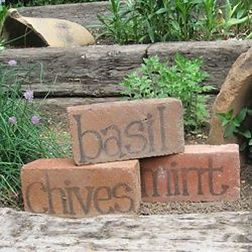 Great idea for using recycled bricks as naming markers for vegies in your garden