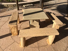 4 Decorative sandstone seats with matching sandstone table
