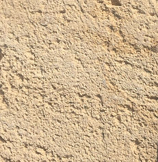 The texture of a natural limestone block