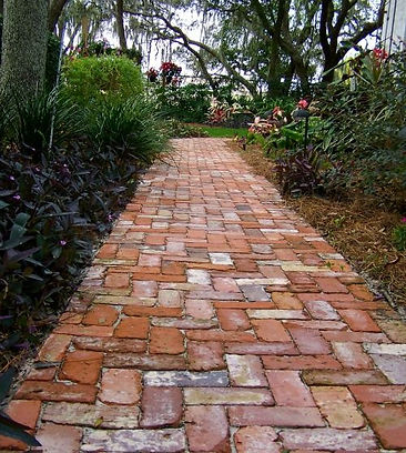 Old recycled bricks used in garden pathway