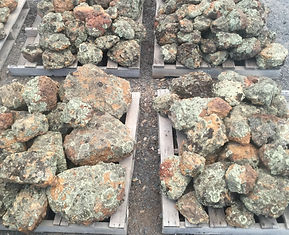 Pallets of moss rock aslo known as bush rock has a lot of moss coverage on rock