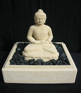 Square based Budha water feature with black decorative pebbles