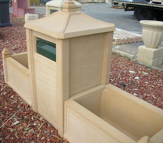 Beautiful sandstone letterbox with sandstone planters boxes to match either side