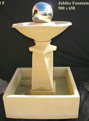 Large Sandstone water fountain with square base, has a silver ball with turns with water
