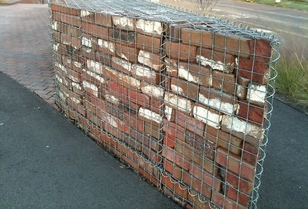 Recycled bricks in gabion cage used as a feature retaining wall