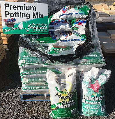 pallets showing bags of mumby magic, premium potting mix, chicken manure and blood and bone stocked at Bunbury Landscaping supplies