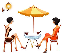 women in beautiful dresses at cafe talking