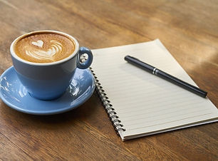 Coffee with notepad