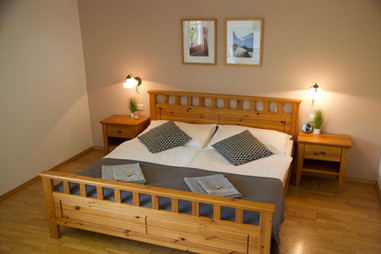 Bedroom two in the Bergner Alm apartment, with a large double bed and separate single bed