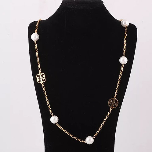 collier perles or Tory Burch pearl necklace