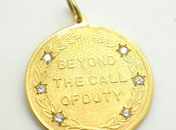 "Vintage ""Beyond The Call of Duty"" Diamond and 14k Yellow Gold Pendant"