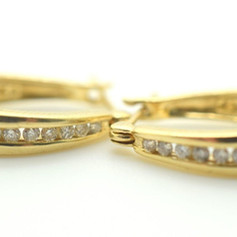 Diamond and 14k Yellow Gold Hoop Earrings Appx. .30 Tcw