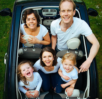 Family in a convertible car