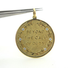 """Vintage """"Beyond The Call of Duty"""" Diamond and 14k Yellow Gold Pendant"""