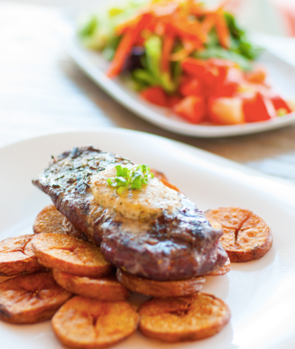 Steak with maduritos and side salad