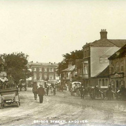 Andover Bridge Street with Henley's Garage to the right and the Post Office to the left.