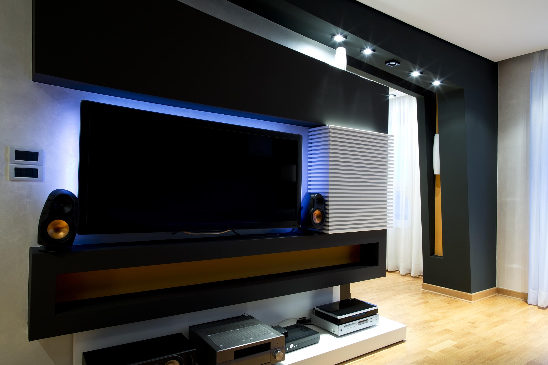 tv with dark black custom furniture in calgary