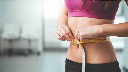 woman-measuring-stomach-1296x728.jpg