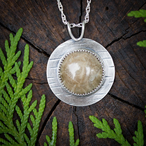 Petoskey stone pendant with sterling silver birch bark setting