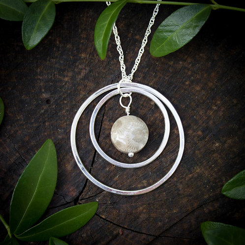 Petoskey stone with concentric circles pendant