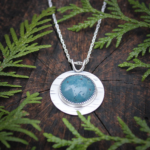 Leland Blue pendant with birch bark patterned setting