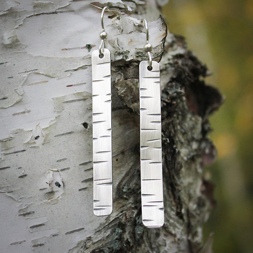 Long birch bark pattern earrings in silver