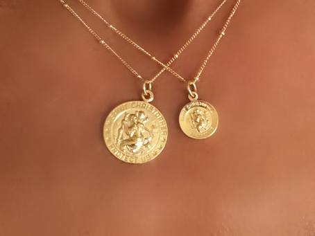 The Meaning Behind our Saint Christopher Medals