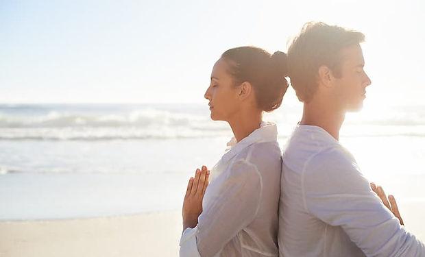 Couple Meditating on the Beach.jpg