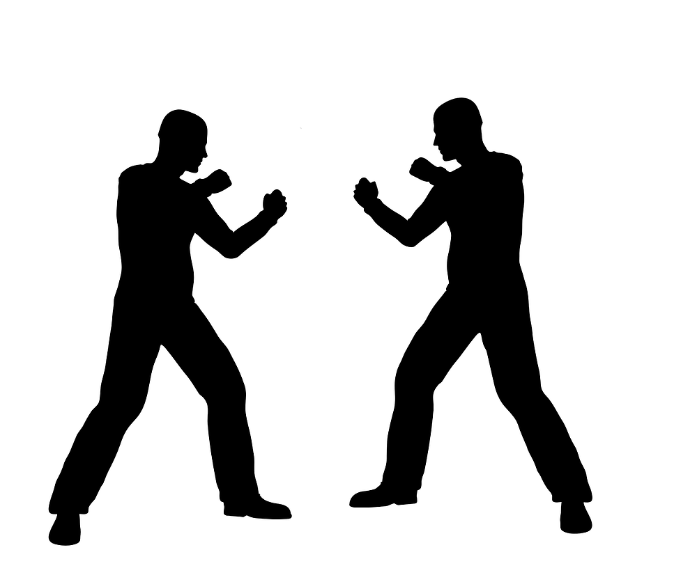 This is a picture of two silohuettes of men against a white background who are fighting each other. The men are facing each other and mirroring each other in a fighting stance with their fists up.