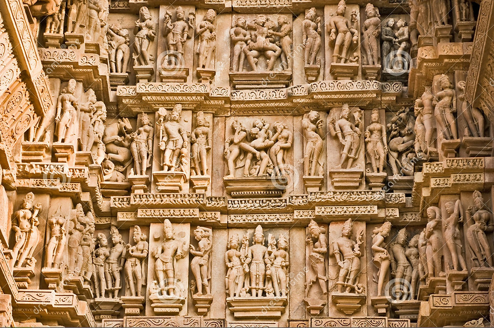 This is a picture of a tan wall covered in sculptures of ancient people.
