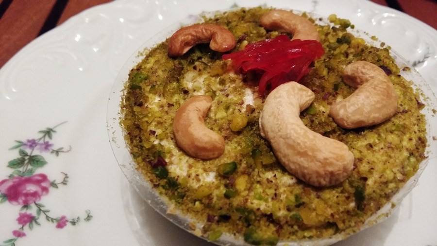 This is a picture of Mafroukeh in a small bowl, which is resting on a plate.