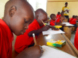 Maasai students coloring ith Crayola crayons and pencils