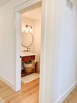 Bathroom vanity with farm sink and door casing