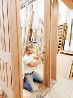 Dean Loppnow Jr. building a entry door