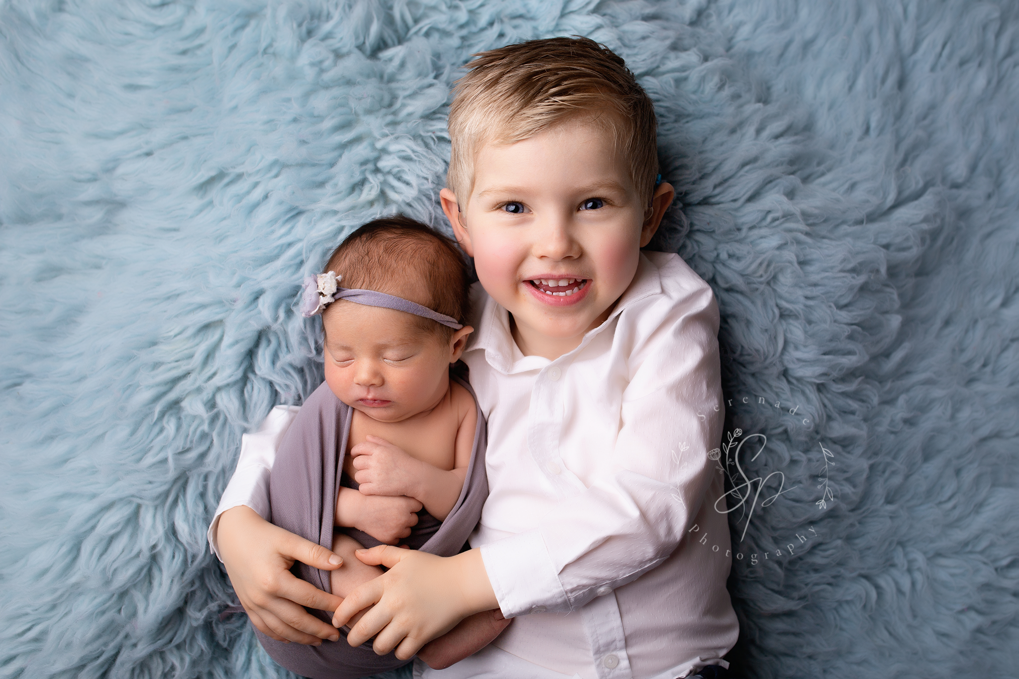 sibbling portrait with new baby girl and big brother