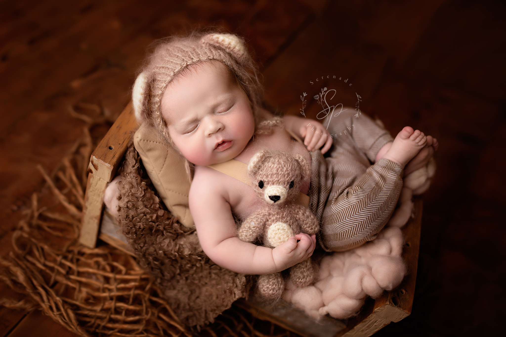 wood setup for newborn baby photoshoot in Chester studio baby holding little teddy