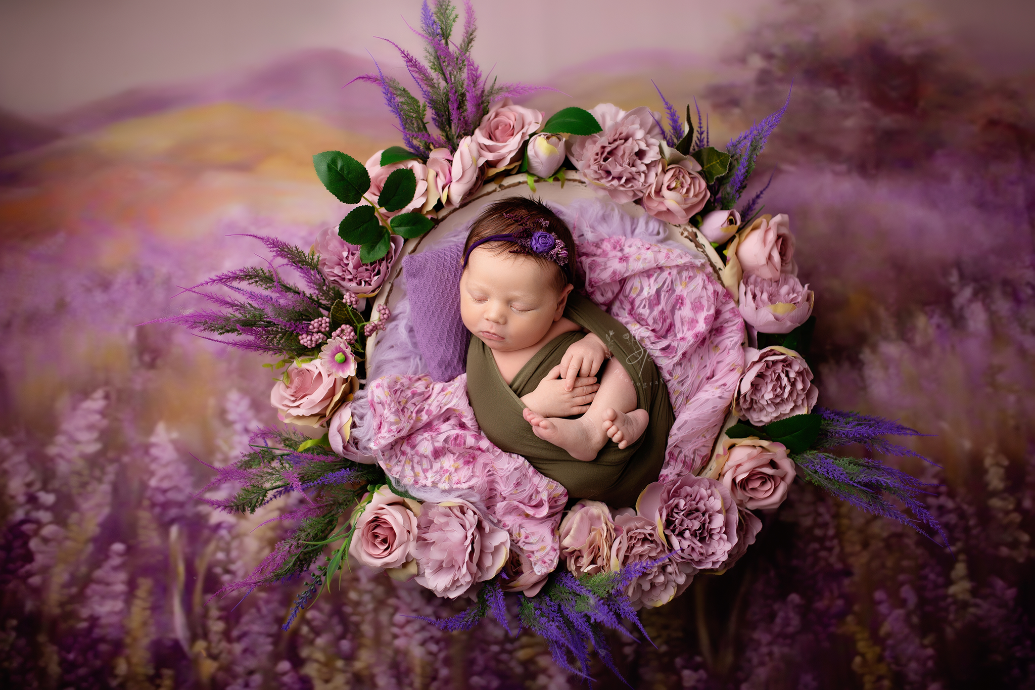 purple flower setup with newborn baby in the bowl