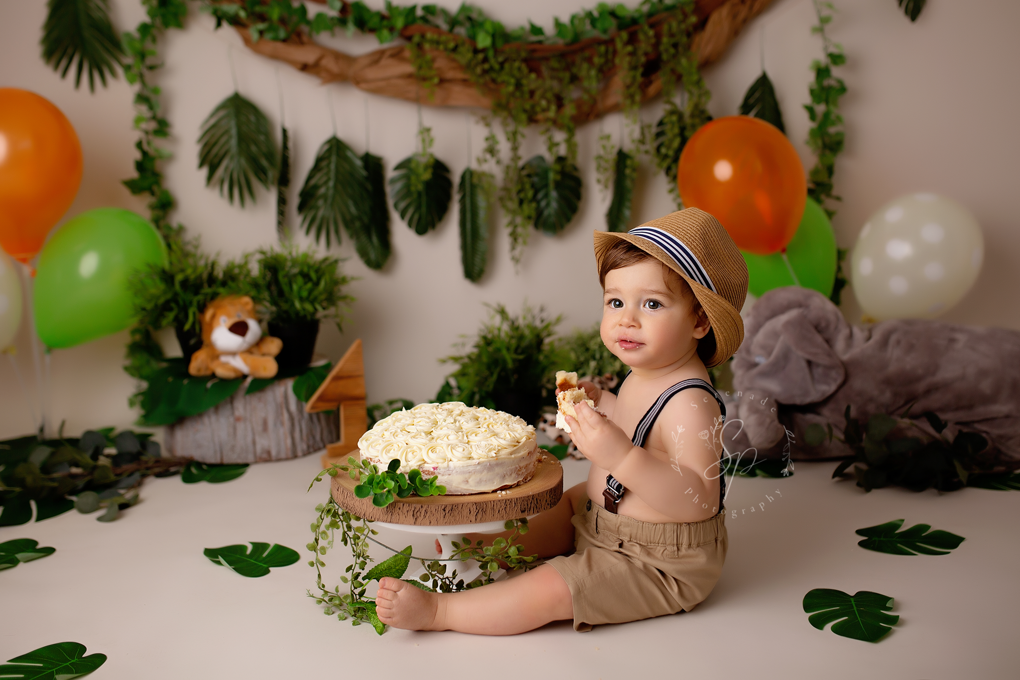 safari themed birthday photoshoot with baby boy wearing hat
