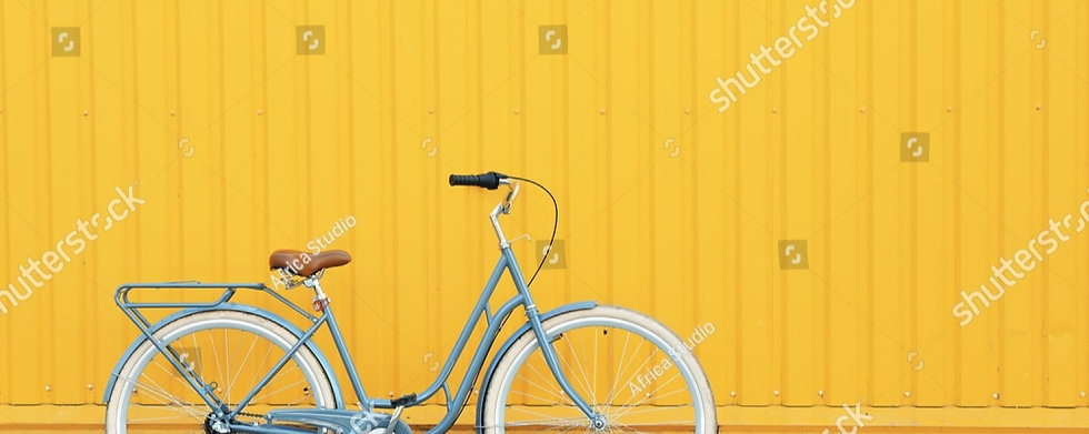 stock-photo-retro-bicycle-near-yellow-wa
