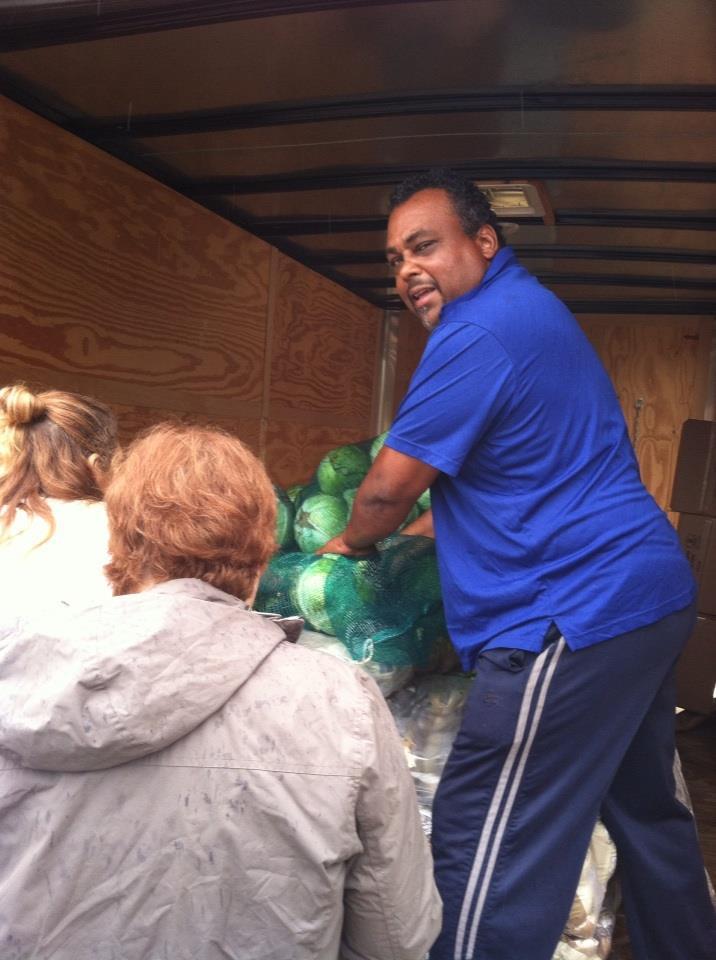 John Jones and An Marie Dunham were handing out the produce in the rain.