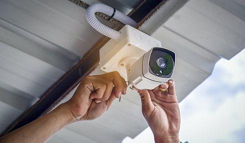 Technician-installing-CCTV-Camera.jpg