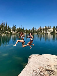 jumpinng into a clear, clean wilderness lake