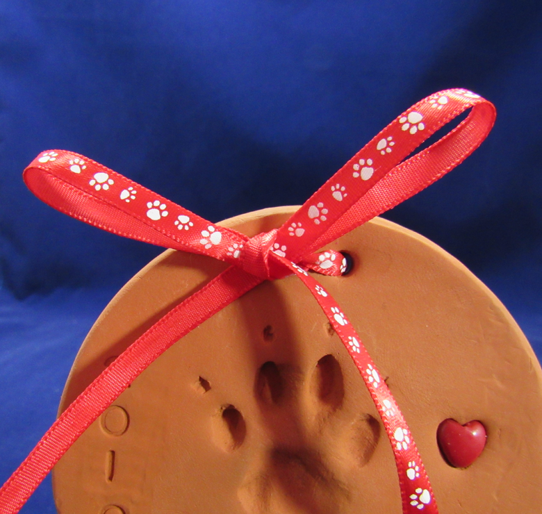 Red Ribbon with White Paw Prints