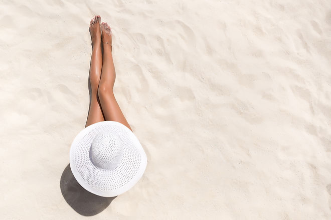 Summer holiday fashion concept - tanning